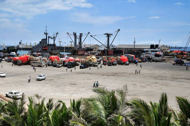 Somalia's seaport bustles with business as trucks come to off load ships of their cargo. UN Photo/Tobin Jones