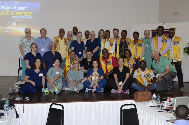 St. Maarten Lions Club members and the visiting VOSH Team pose for a group picture after the conclusion of the Lions Sight Project at the Belair Community in May 2018.