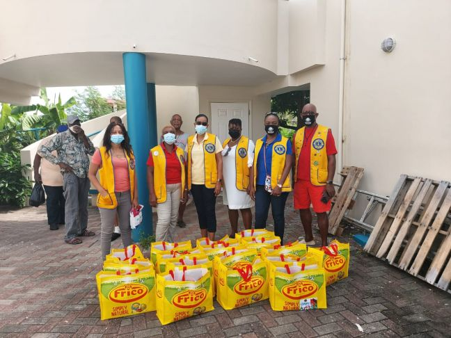 Sint Maarten Lions Club members with the food baskets that were delivered to the seniors living in the Red Cross Homes in Belvedere.