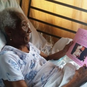 100-year-old Carmen Hodge Carrington Proudly Holds a Copy of Her Love Story