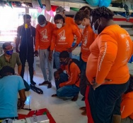 Nine students learn the basics of sail making