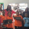Foresee Foundation acknowledging Excellence Learning Academy with 25 tablet DigiKidz donation